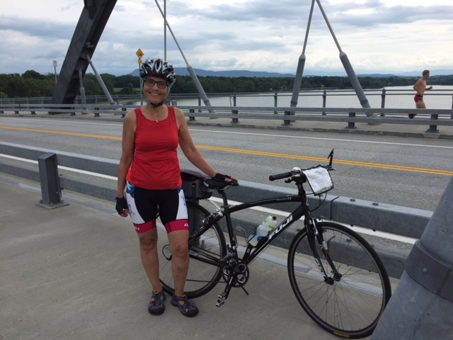 Orysia and bike on bridge